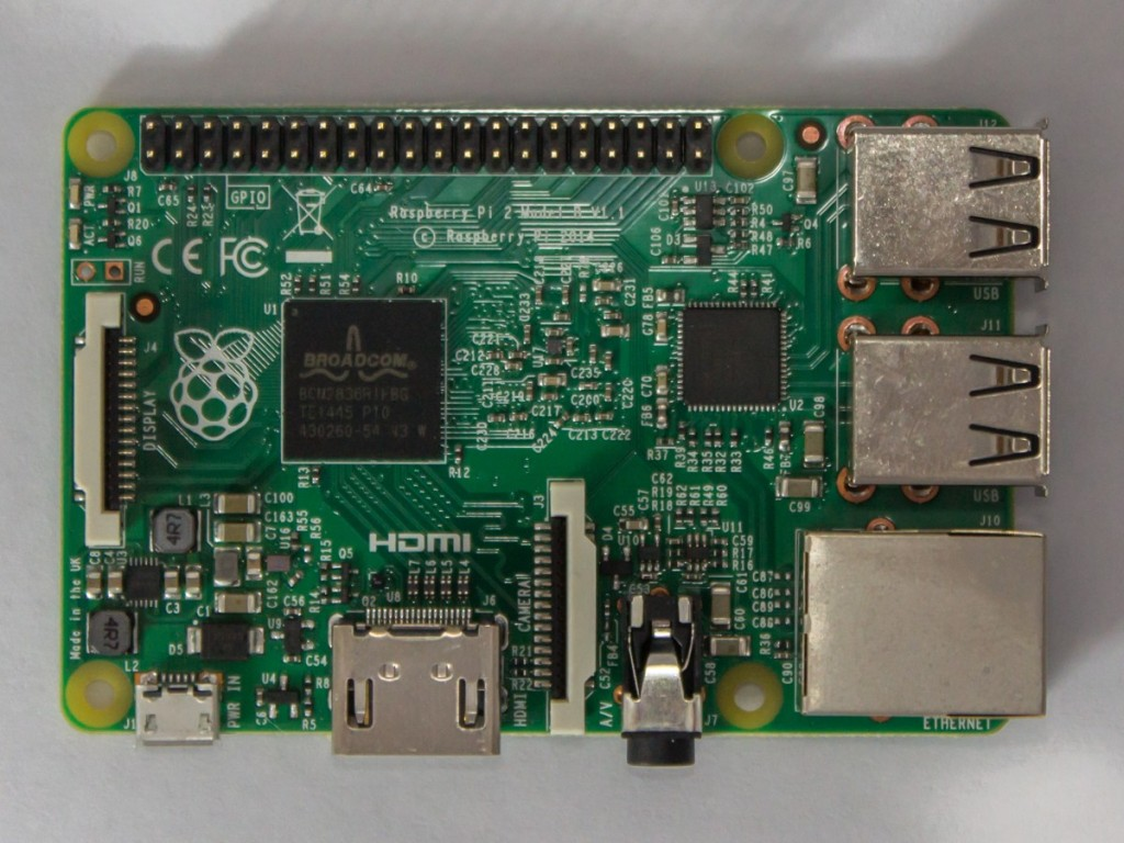 With the memory no longer mounted on top, you can see the Broadcom logo on the SoC.